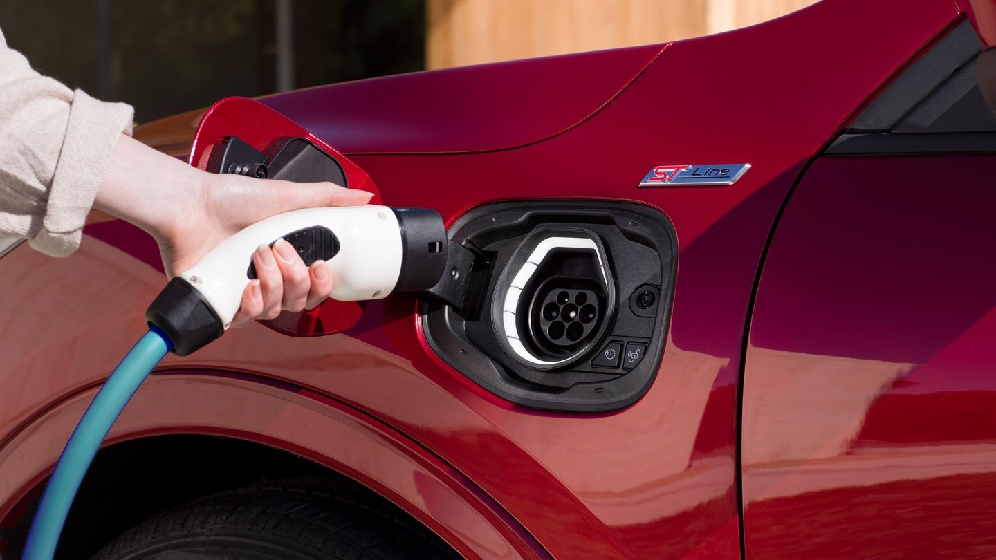 A woman charging a New Ford Kuga Plug-In Hybrid