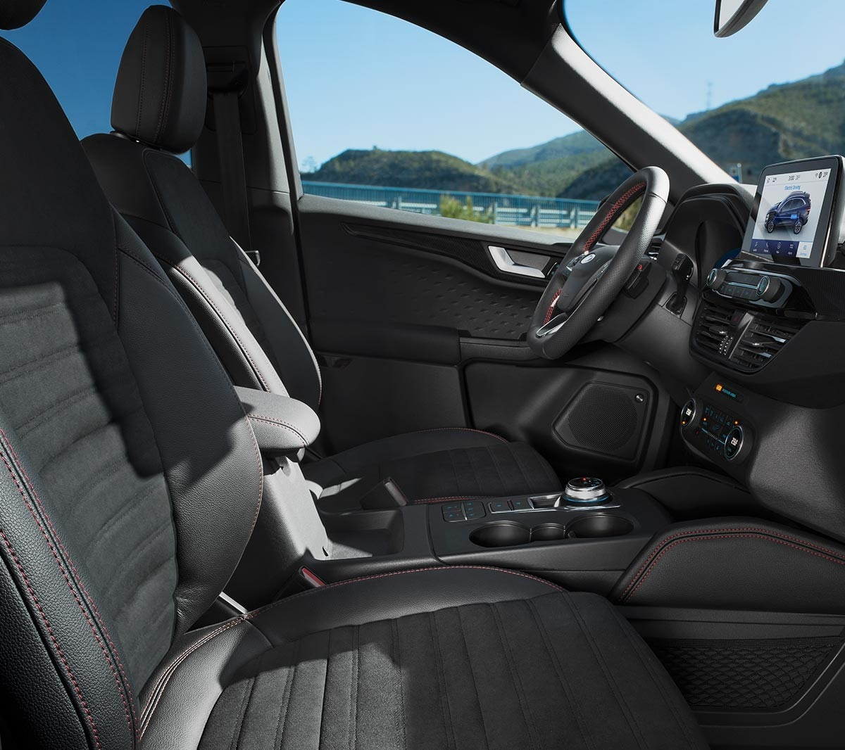 All New Ford Kuga interior showing steering wheel, SYNC3 and leather seats