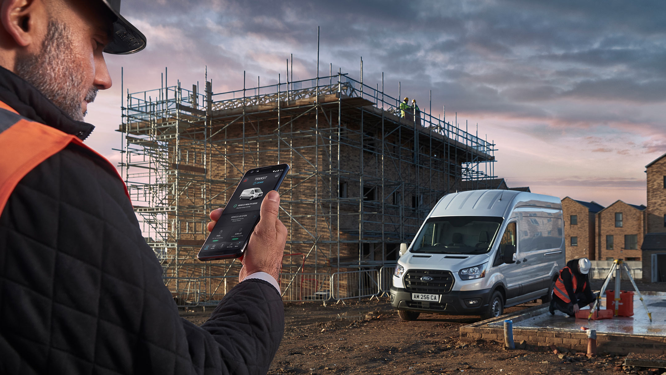 Ford Telematics being shown by man at building site