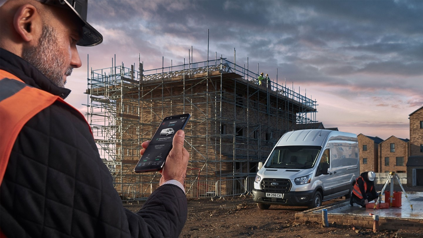 Construction worker checking the FordPass Pro App